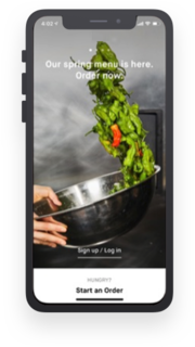 An image of a mobile phone screen with a login page of a restaurant is shown.