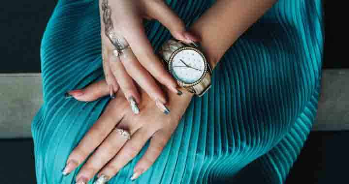 Image displaying a woman's stylish analog wrist watch to portray London Time.