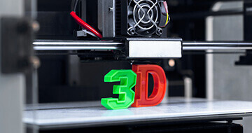 Image displaying 3D printer to portray the company Makerbot