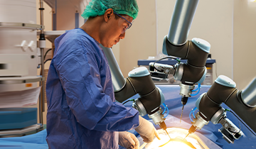 Image of a surgeon using robotic tools for surgery