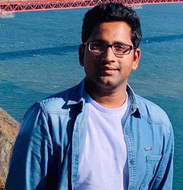Tulasi Vijaya Kumar Thulluru wearing a blue shirt