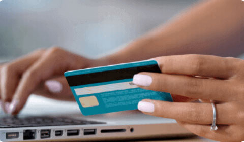 Image of a lady using a card to make a payment online to portray the company PayPal