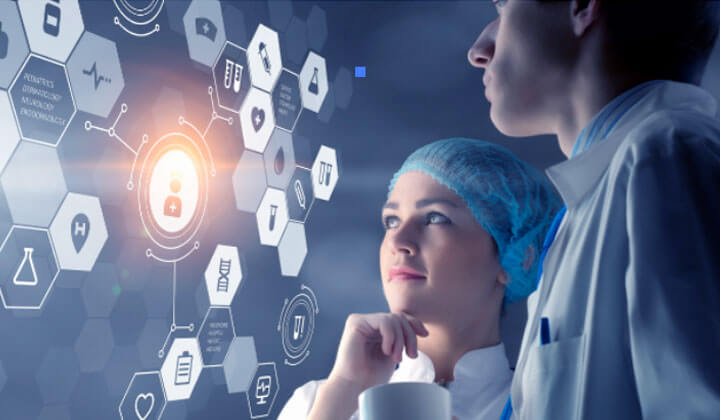 Image of doctors looking at a digital data screen to depict the concept of Intenet of Things in the medical industry