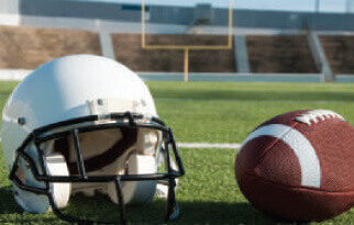 Image of a helmet and football in a stadium to potray the National Football League (NFL) case study