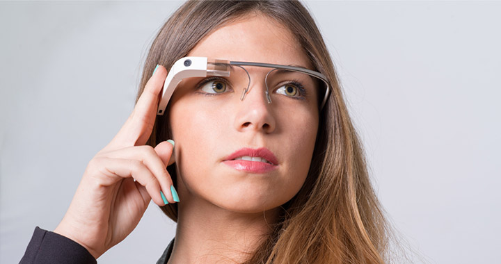 Image of a woman wearing sleek VR glasses to portray Moonshot: Google Glass