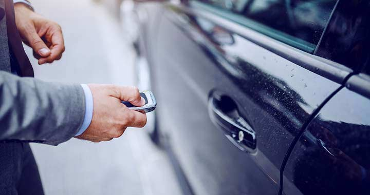 Image of a hand unlocking car to portray the case study of Zipcar