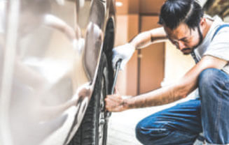 Image of a mechanic fixing a car to potray the Japanese Auto Industry case study