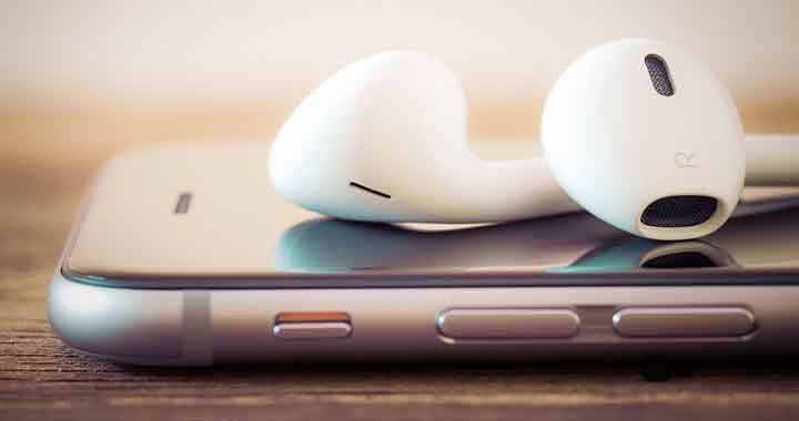 Image of an iPhone and earphones to portray the case study of Apple