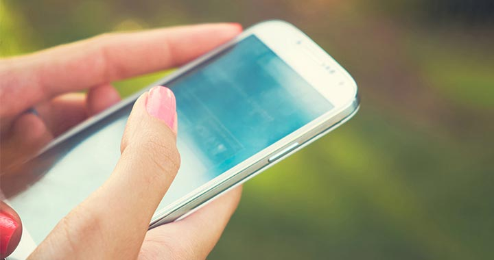 Image of a woman's hand using her smartphone to portray the case study of Google