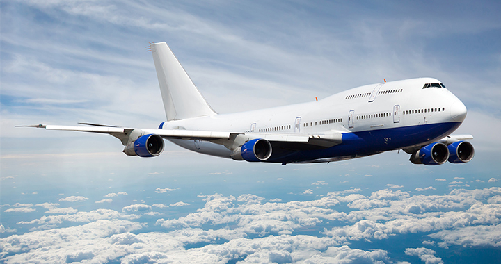Image of an airplane mid air to portray the case study of Boeing