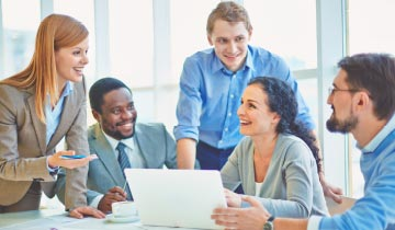 Image of people engaged in a discussion in an office to portray a corporate strategy case study